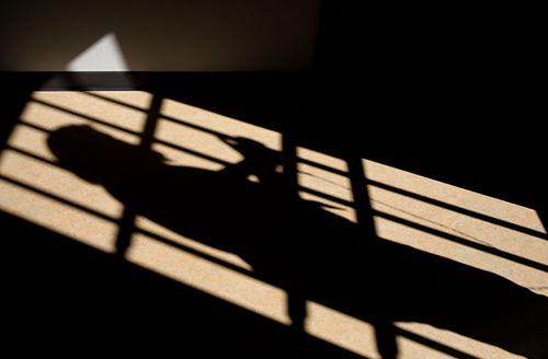 A shadow is cast of a cell door of a male prison on March 15, 2017, in Wrexham, Wales.