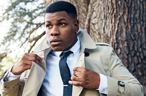 John boyega discusses race sci fi in new gq cover story colorlines black man in white dress shirt and navy tie and pants and tan overcoat in front ccuart Choice Image