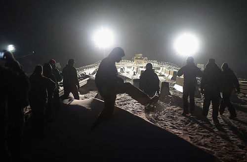 Military veterans confront police guarding a bridge near Oceti Sakowin Camp on the edge of the Standing Rock Sioux Reservation on December 1, 2016, outside Cannon Ball, North Dakota, during a protest against the Dakota Access Pipeline.