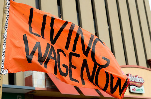 """Sign reads: """"Living wage now."""""""
