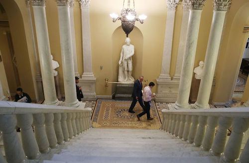 Chuck Schumer at bottom of stairs
