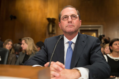 Photo of Alex Azar in a suit seated at a Senate confirmation hearing