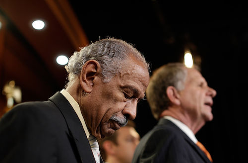 John Conyers Jr., head bowed
