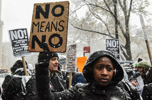 "Black woman at protest carries sign that reads, ""No means no."""