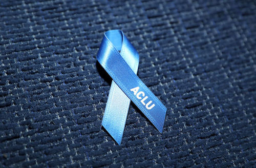 Blue ribbon with white text sits on darker blue background