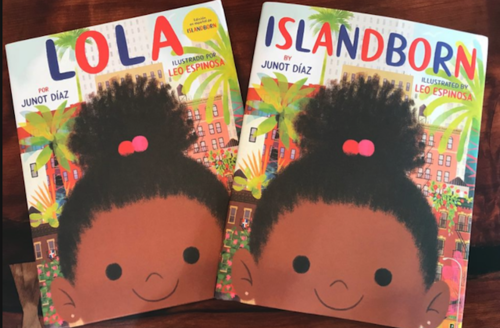 Book covers with illutrations of Brown girl with black hair in front of green trees and pink and brown buildings on brown table