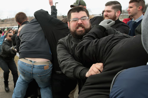 A group of rotund White men wearing black fight.