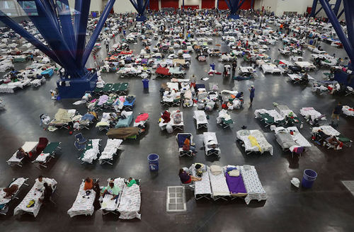 People take shelter at the George R. Brown Convention Center after flood waters from Hurricane Harvey inundated the city on August 29, 2017 in Houston, Texas.