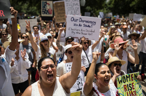 Thousands march across US to protest Trump immigration policies.