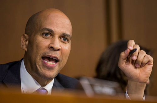 Cory Booker. Black man with bald head close to the camera.