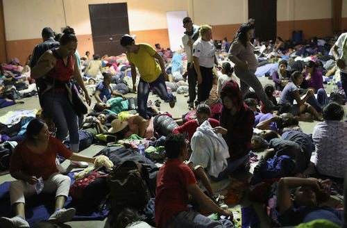 Large group of Honduran migrants prepare to sleep at an overnight immigrant shelter on October 15, 2018 in Esquipulas, Guatemala.