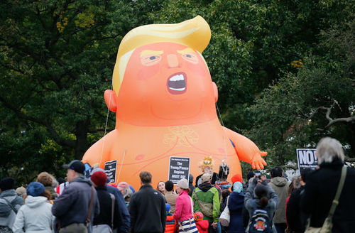 The Baby Trump Balloon rises after being inflated in Battery Park as part of an 'Impeachment Parade' protest in New York City on October 28, 2018.