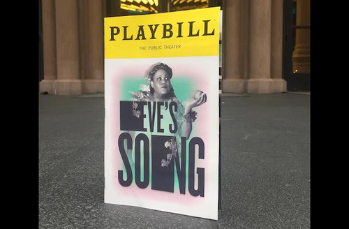 """Poster with yellow top bar and black text reading """"PLAYBILL"""" and Black woman on white and pink and turquoise background behind black text that reads """"EVE'S SONG"""" on grey pavement in front of brown building"""