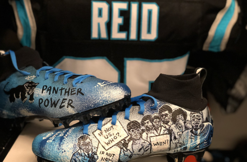 """Eric Reid;.blue and white football cleats with Black Panther Party symbol and protestors in black and white with text that reads """"PANTHER POWER"""" and """"IF NOT NOW, WHEN?"""" in front of black jersey with blue stripes and white letters that spell """"REID"""""""