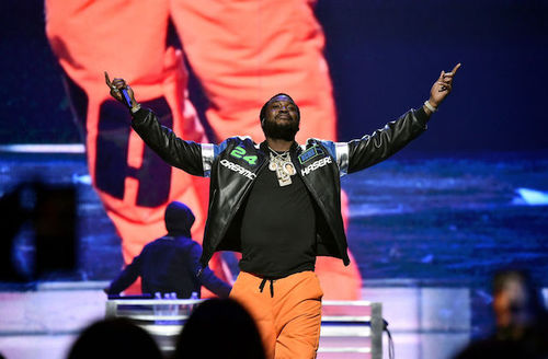 Meek Mill raises his arms in victory on stage during the 4th Annual TIDAL X: Brooklyn at Barclays Center in Brooklyn, NY on October 23, 2018.