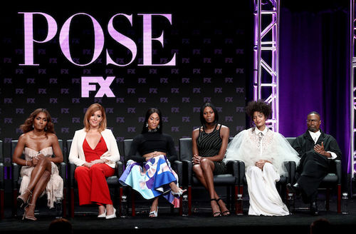 """Janet Mock, Mj Rodriguez, Dominique Jackson, Indya Moore, Billy Porter. Group of Black actors and filmmakers and one White producer on stage with a purple light and purple curtain behind them and a black banner that reads in purple letters """"Pose FX"""""""