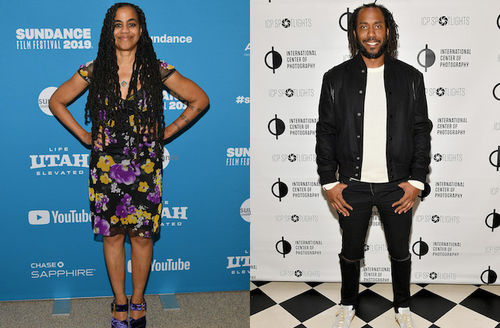 Suzan-Lori Parks and Rashid Johnson. Black woman with black hair in black and purple and yellow dress in front of blue wall with white text; Black man with black dredlocs in black pants and jacket and white shirt in front of white wall with black text