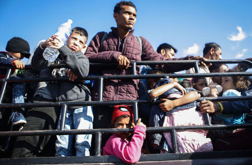 Central American migrants in Santo Domingo Zanatepec, Mexico wait to ride on a truck while on their way to the United States  on January 22, 2019.