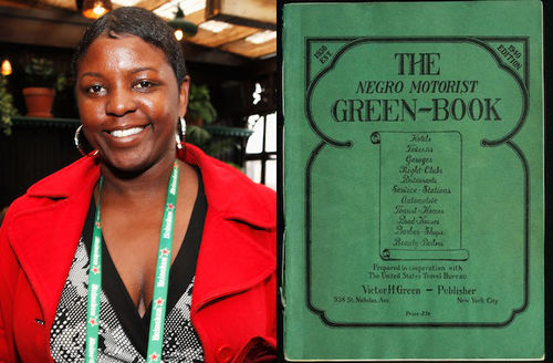 Yoruba Richen. Black woman smiles in red jacket and black and grey blouse and green lanyard with white text in front of brown lights and walls