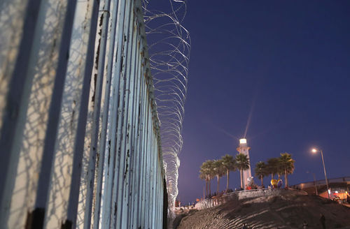 A Mexican lighthouse shines above the U.S.-Mexico border fence in San Diego, CA, as seen from Tijuana, Mexico on November 16, 2018.
