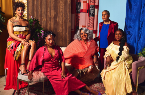 Tourmaline, Charlene Carruthers, Miss Major, Alicia Garza and Barbara Smith. Black women in blue and red and orange and yellow clothing pose in various positions in front of brown wood and blue walls