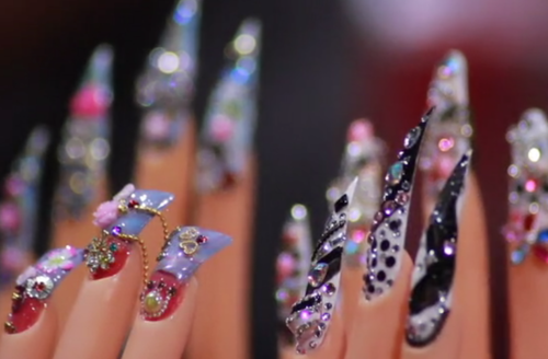 Nailed It. A row of colorful pointed nails with gems.