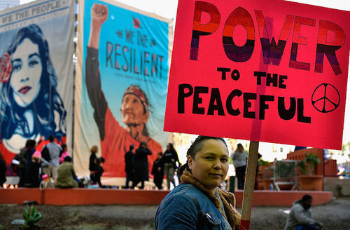 Native American woman holds protest sign a Women's March in Los Angeles