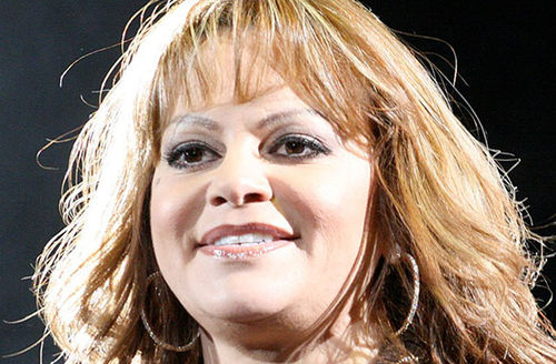 Jeni Rivera. Middle-aged Latinx woman with blond hair.