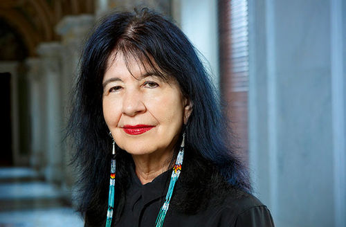 Joy Harjo. Middle-aged Native American woman with long dark hair and black top.