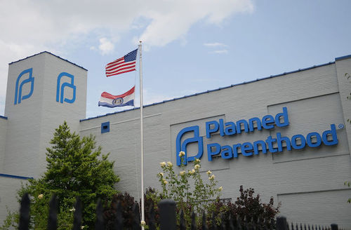outside of St. Louis Planned Parenthood with Missouri and U.S. flags