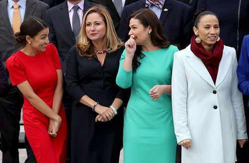 Alexandria Ocasio-Cortez, Debbie Mucarsel-Powell, Abby Finkenauer and Sharice Davids. Diverse group of women standing side-by-side.