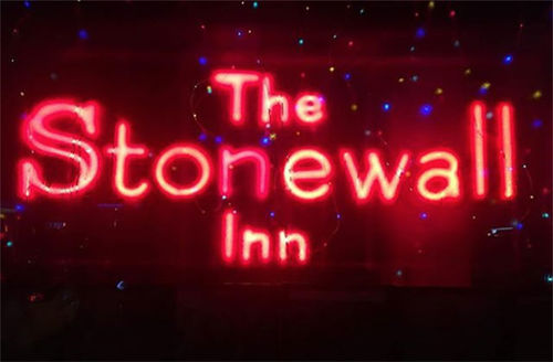 """Stonewall Inn. Neon red signage reads """"The Stonewall Inn."""""""