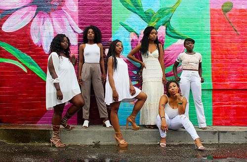 Black Millennial Survey. Six Black women wearing pants and dresses, all dressed in white.