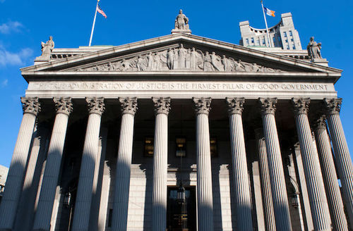 """New York State Supreme Court building in Manhattan showing the words """"The True Administration of Justice"""" on its facade."""