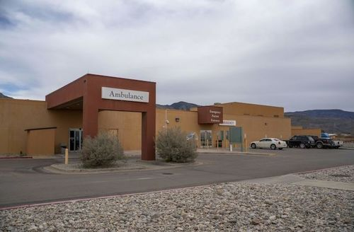 A large sign reads Ambulance over the Gerald Champion Regional Medical Center in Alamogordo, New Mexico.