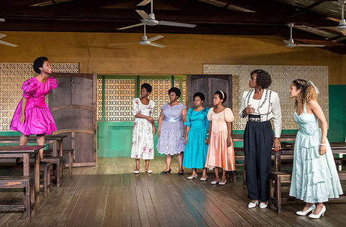 """""""School Girls; Or, The African Mean Girls Play."""" Seven Black women in a school room with six dressed in colorful dresses."""