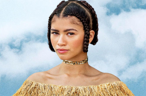 Zendaya. Young Black woman wearing braids and raffia off-the-shoulder top.
