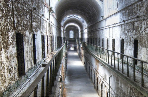 Inside of a prison showing cells.