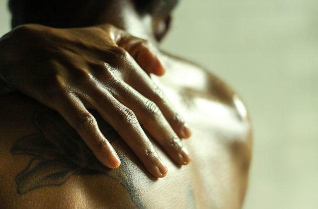 photo essay the artist s way to self care colorlines a black person caresses their bare shoulder