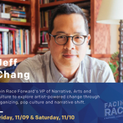 Jeff Chang sits in front of a book shelf