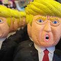 A cartoon rendering of an angry Donald Trump in the form of a piñata