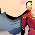 Kenan Kong in red Super-Man outfit, yellow-beige sky in background