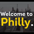"""White and yellow lettering reads """"Welcome to Philly."""""""