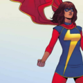 Brown girl in red, white and yellow superhero outfit with red cape against light blue background