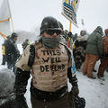 Despite blizzard conditions, military veterans marched in support of water protectors at Oceti Sakowin Camp on the edge of the Standing Rock Sioux Reservation on December 5, 2016, outside Cannon Ball, North Dakota. Now, vets are looking to head to Flint.