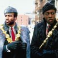 Black man superimposed onto body with grey coat and hat next to Black man with charcoal hat and coat against white-covered winter background