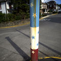 A rusted steel pole with red, white and blue stars and stripes in rural Pennsylvania