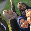 Four smiling Muslim girls