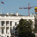 "Greenpeace activists deploy a banner on a construction crane near the White House reading ""RESIST"" on President Donald Trump's fifth day in office, January 25, 2017."