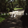 White text against image of boy in Black hoodie on bicycle, riding down grey cement road lined by green trees